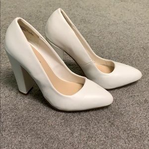 White pointed toe heels